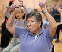 Photo of a woman lifting weights. Links to Gifts of Appreciated Securities