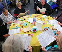 Photo of a group of people reading. Links to What to Give